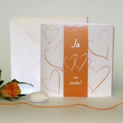 Hochzeitseinladung in romantischem orange