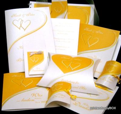 Hochzeitskollektion mit 2 verschlungenen Herzen in gelb