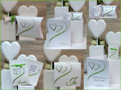 Grün-weiße Hochzeitspapeterie mit verschlungenen Herzen.