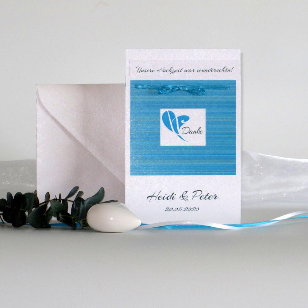 Danksagung Fototasche aus weißem Karton mit türkisem Aufdruck.