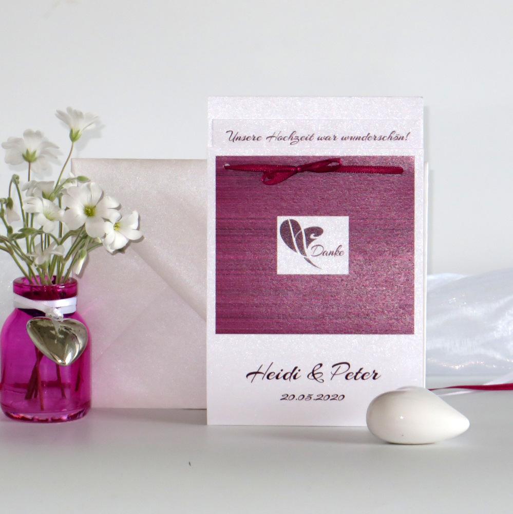 Danksagung Fototasche mit Streifen, einem Herz und weiteren Details in pink und aubergine.