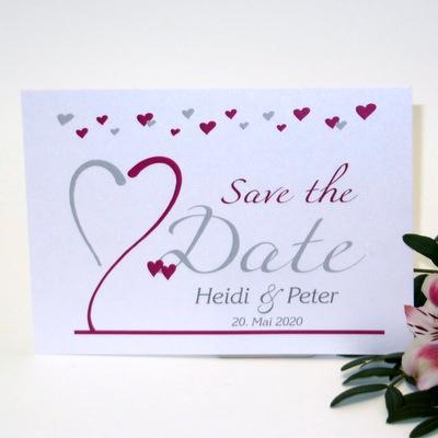 Personalisierte Save-the-Date-Karte in weiß und pink.