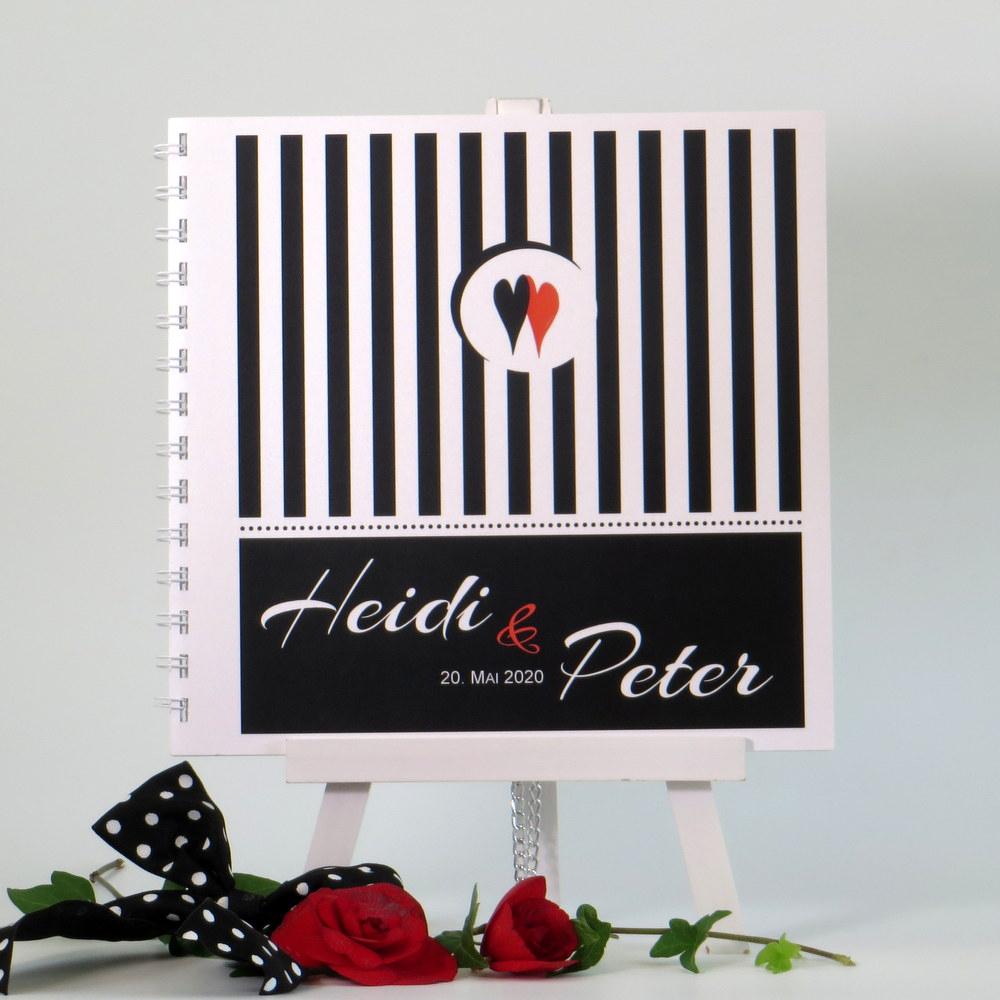 Hochzeitsgästebuch für eine Rockabilly-Hochzeit in schwarz und weiß.