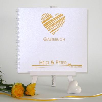 Hochzeitsgästebuch mit gelbem Aufdruck.