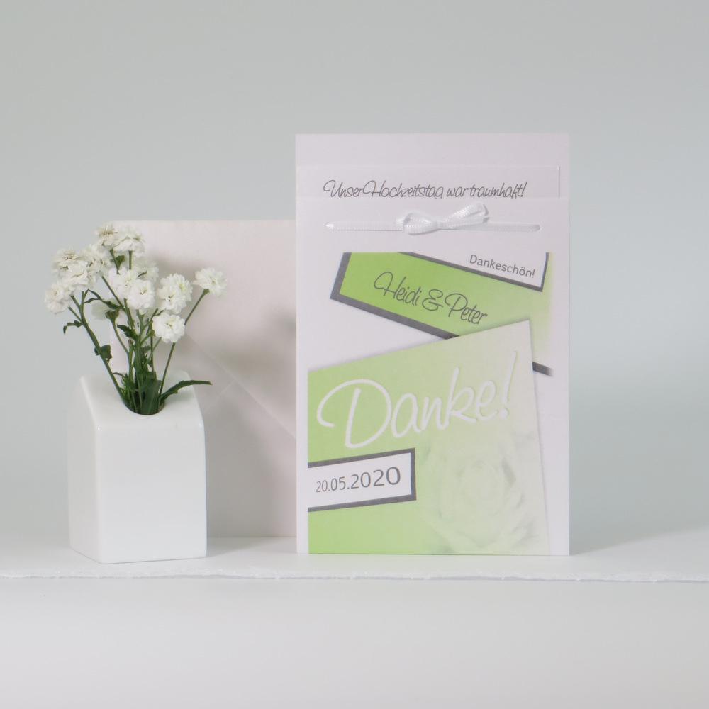 Hochzeitsdanksagung in grün mit Rosen.