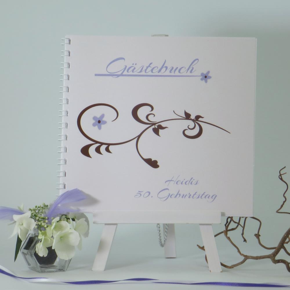 Schmuckes Geburtstagsgästebuch mit fröhlichem Rankenmotiv in flieder und braun