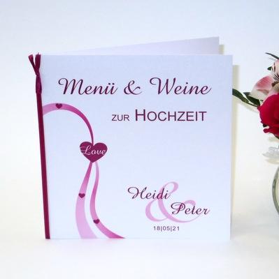 Menükarte für eine Hochzeit mit einem Motiv in pink und weiß.