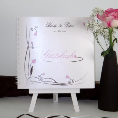 Modernes Gästebuch für eine Hochzeit in rosa und braun.