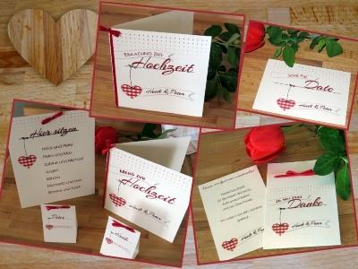 Hochzeitspapeterie für eine Feier in Tracht mit roten Details.
