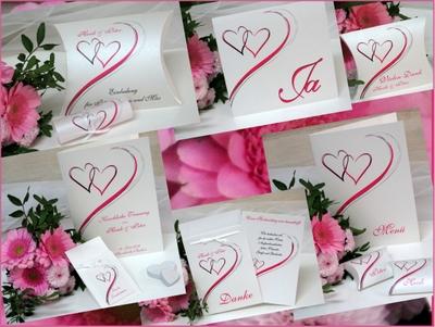 Trendy Hochzeitspapeterie mit Herzen in pink und einem modernen Design.