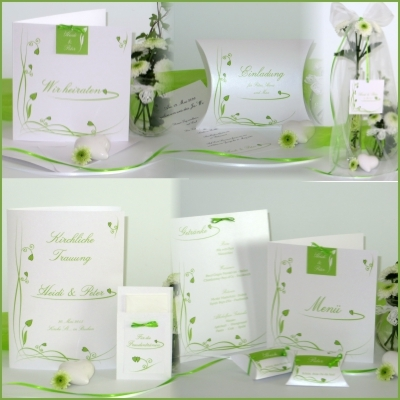 Stilvolle Hochzeitspapeterie mit grünen Ranken und Herzen.