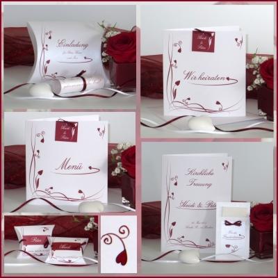 Hochzeitskarten mit edlen roten Ornamenten und Herzen.