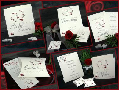 Edle Hochzeitspapeterie mit roten Details und elegantem creme als Basis.