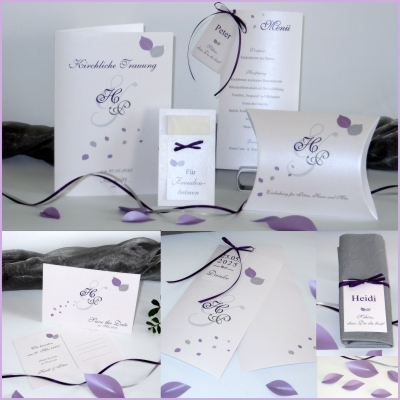 Schlichte und doch besondere Hochzeitspapeterie mit lila Details und Schleifen.