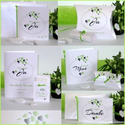 Hochzeitspapeterie mit Herzen und Blättern in frischem grün.