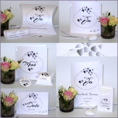 Trendige Hochzeitskarten mit Blättern und Details in taupe und grau.