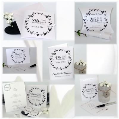 Schwarz-weiße Hochzeitspapeterie mit modernen Herzen und besonderen Schriften.