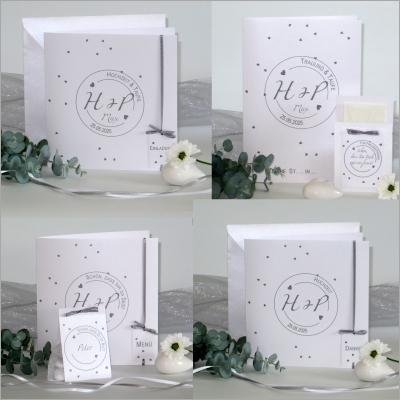 Karten für die Hochzeit mit Taufe, die dezent in grau und weiß gestaltet sind.
