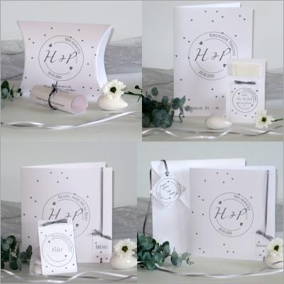 Hochzeitspapeterie dezent in grau und weiß mit vielen besonderen Details.