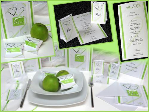 Moderne Hochzeitskarten in grün und weiß dargestellt auf einer gedeckten Tafel mit ausgefallenen Menükarten für Ihre Hochzeit.
