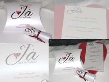 Hochzeitseinladung als Box mit einer Schriftrolle und roten Herzen. Die Einladungsbox ist außergewöhnlich und besonders