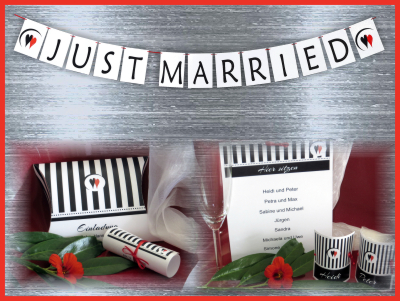 Hochzeitsgirlande in schwarz und weiß mit roten Herzen.