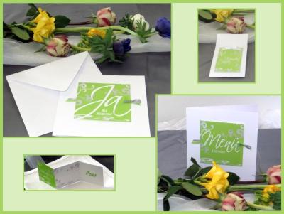 Moderne Set mit Hochzeitseinladungen, Menükarten, Tischkarten und einer passenden Deko in grün.