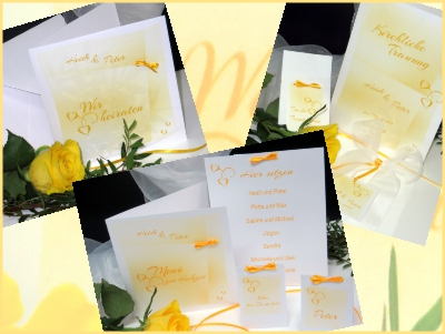 Hochzeitskarten und Deko in sonnigem gelb und strahlendem weiß.