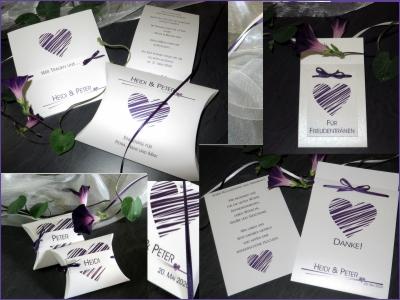 Hochzeitspapeterie mit lila Herzen und Bändern