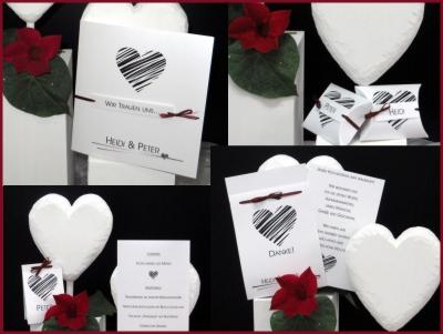 Schwarz-weiße Hochzeitsseinladung und weitere Papeterie mit dem gewissen Etwas und kleinen roten Details.