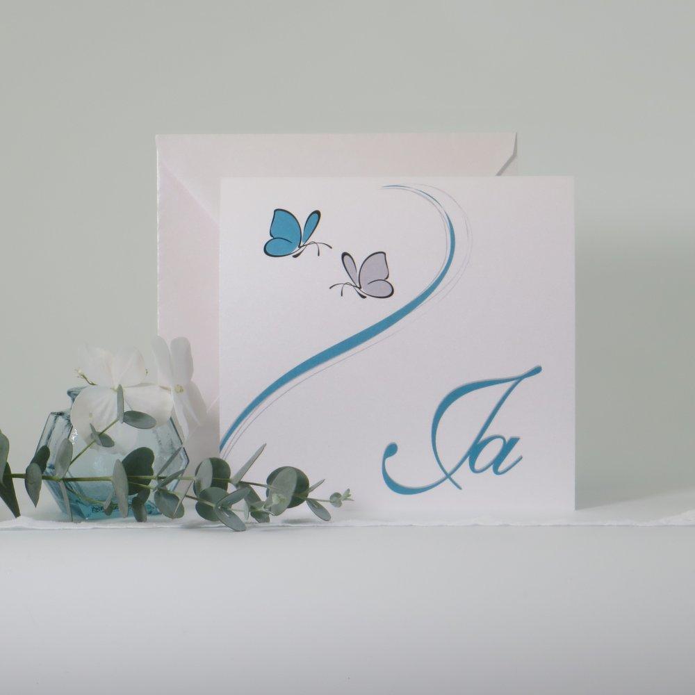 Schmetterlinge türkis und weiß
