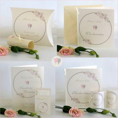 Zauberhafte Hochzeitskarten mit zarten Blumen und Herzen in rosa und einem edlen Schimmer.